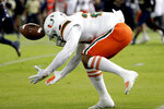Miami running back Cam'Ron Harris cannot hold onto the football during the first half of an NCAA college football game against Miami, Saturday, Nov. 23, 2019, in Miami. (AP Photo/Lynne Sladky)