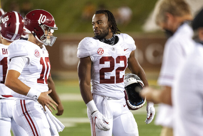 Alabama running back Najee Harris, right, jokes with quarterback Mac Jones, left, as they walk off the field during the second half of an NCAA college football game against Missouri, Saturday, Sept. 26, 2020, in Columbia, Mo. (AP Photo/L.G. Patterson)