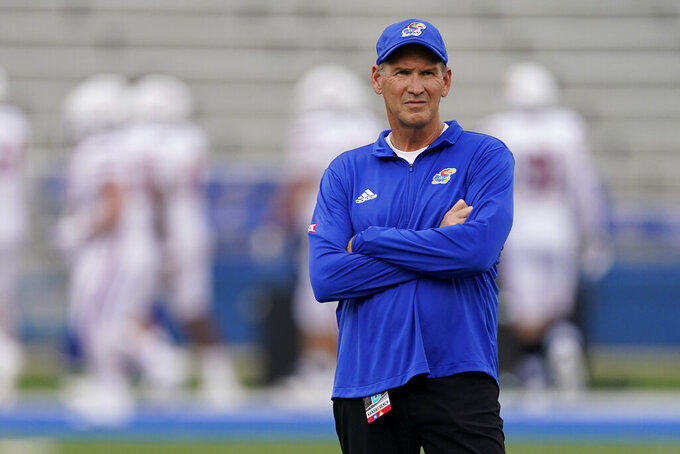 Kansas head coach Lance Leipold watches warmups before an NCAA college football game against South Dakota Friday, Sept. 3, 2021, in Lawrence, Kan. (AP Photo/Charlie Riedel)