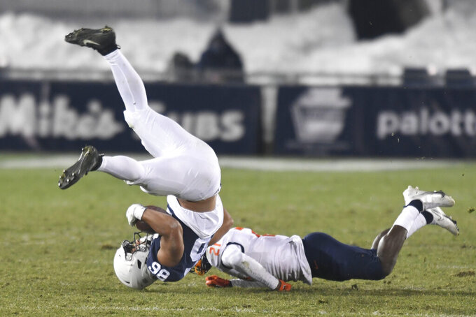 Penn State tight end Brenton Strange (86) is upended by Illinois defensive back Jartavius Martin (21) after a catch in the third quarter of an NCAA college football game in State College, Pa., on Saturday, Dec. 19, 2020. (AP Photo/Barry Reeger)