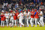 The Philadelphia Phillies celebrate after defeating the New York Mets in a baseball game, Saturday, Sept. 18, 2021, in New York. The Phillies won 5-3. (AP Photo/Mary Altaffer)
