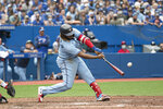 Toronto Blue Jays' Vladimir Guerrero Jr. hits a home run in the fifth inning of a baseball game against the Boston Red Sox in Toronto, Sunday, Aug. 8, 2021. (Christopher Katsarov/The Canadian Press via AP)