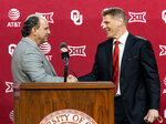 University of Oklahoma vice president and director of athletics Joe Castiglione, left, shakes hands with new men's NCAA college basketball coach Porter Moser during his introductory press conference at Lloyd Noble Center in Norman, Okla., Wednesday, April 7, 2021. (Chris Landsberger/The Oklahoman via AP)