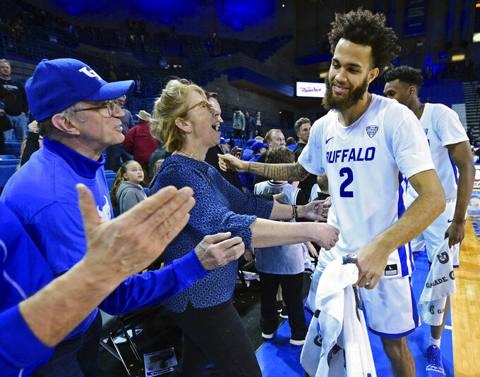 FILE - In this Tuesday, Jan. 8, 2019, file photo, Buffalo guard Jeremy Harris (2) is congratulated by fans after the team defeated Toledo 110-80 in an NCAA college basketball game, in Amherst, N.Y. Buffalo is off to its best start in school history. (AP Photo/David Dermer, File)