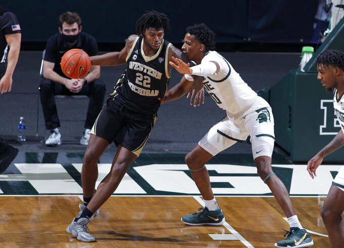 Western Michigan's Titus Wright, left, works against Michigan State's Marcus Bingham Jr. during the first half of an NCAA college basketball game, Sunday, Dec. 6, 2020, in East Lansing, Mich. (AP Photo/Al Goldis)