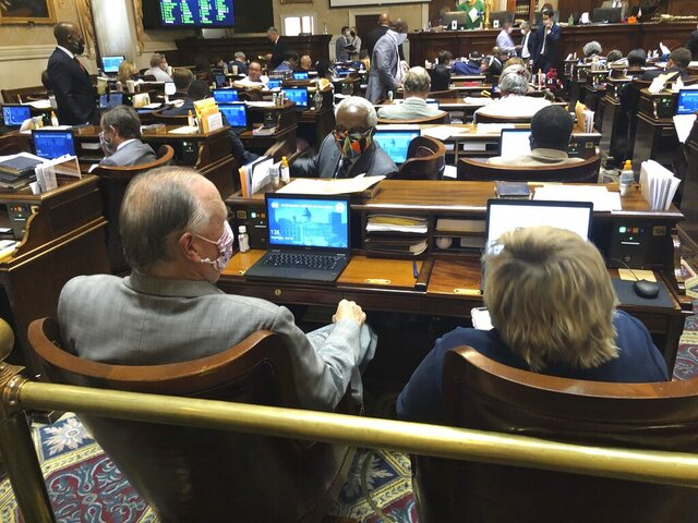 State Rep. Terry Alexander turns around to talk to fellow lawmakers during a South Carolina House session on Wednesday, June 24, 2020, in Columbia, South Carolina. The House approved how to spend $1.9 billion in COVID-19 aid from the federal government. (AP Photo / Jeffrey Collins)