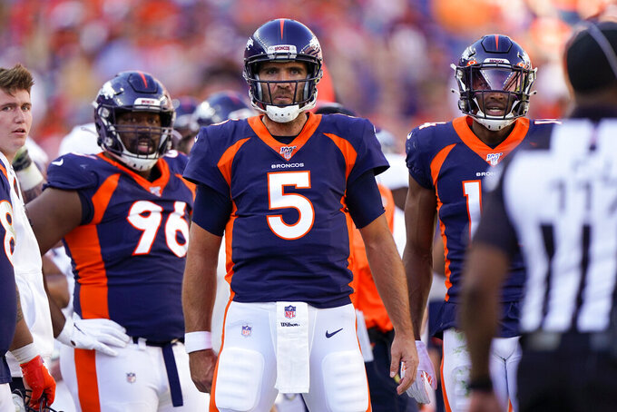 Denver Broncos quarterback Joe Flacco (5) reacts towards field judge John Jenkins, right, after a call during the first half of an NFL football game against the Tennessee Titans, Sunday, Oct. 13, 2019, in Denver. (AP Photo/Jack Dempsey)