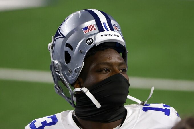 Dallas Cowboys wide receiver Michael Gallup walks off the field after their NFL football game against the Philadelphia Eagles in Arlington, Texas, Sunday, Dec. 27. 2020. (AP Photo/Ron Jenkins)