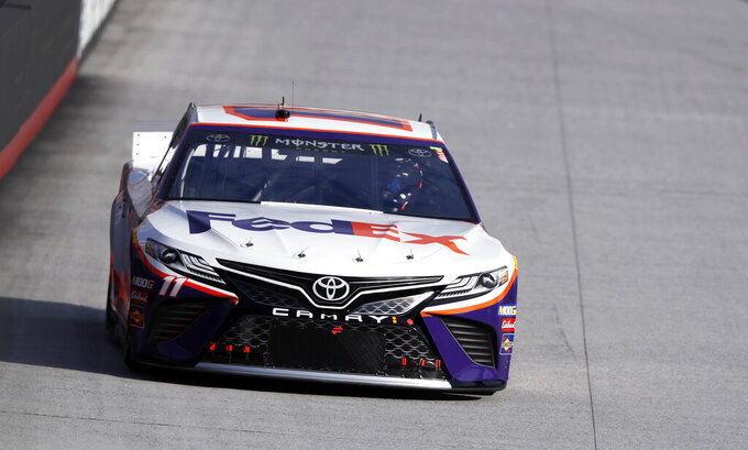 Driver Denny Hamlin (11) makes his way around the track during practice for a NASCAR Cup Series auto race, Saturday, April 6, 2019, in Bristol, Tenn. (AP Photo/Wade Payne)