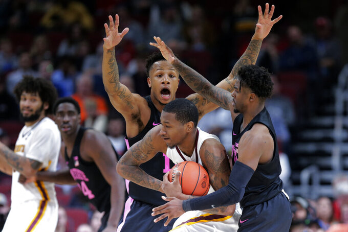 Minnesota's Dupree McBrayer, center, battle for the loose ball against Penn State's Lamar Stevens, left, and Jamari Wheeler during the second half of an NCAA college basketball game in the second round of the Big Ten Conference tournament, Thursday, March 14, 2019, in Chicago. (AP Photo/Kiichiro Sato)