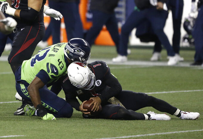 Seattle Seahawks defensive end Carlos Dunlap (43) sacks Arizona Cardinals quarterback Kyler Murray (1), late in the second half of an NFL football game, Thursday, Nov. 19, 2020, in Seattle. The Seahawks won 28-21. (AP Photo/Lindsey Wasson)