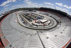 FILE - The stands sit empty as drivers prepare for the start of a NASCAR Cup Series auto race at Bristol Motor Speedway in Bristol, Tenn., in this May 31, 2020, file photo. Sports amid the pandemic became a whole different sort of spectacle, especially when it came to spectators — often with zero. (AP Photo/Mark Humphrey, File)