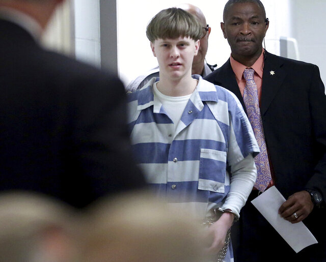 "FILE - In this Monday, April 10, 2017 file photo, Dylann Roof arrives to a courtroom at the Charleston County Judicial Center in Charleston, S.C., to enter his guilty plea on murder charges. The white supremacist church shooter staged a hunger strike in February 2020 while on federal death row, alleging in letters to The Associated Press that he's been ""targeted by staff,"" ""verbally harassed and abused without cause"" and ""treated disproportionately harsh."" (Grace Beahm/The Post And Courier via AP, Pool, File)"