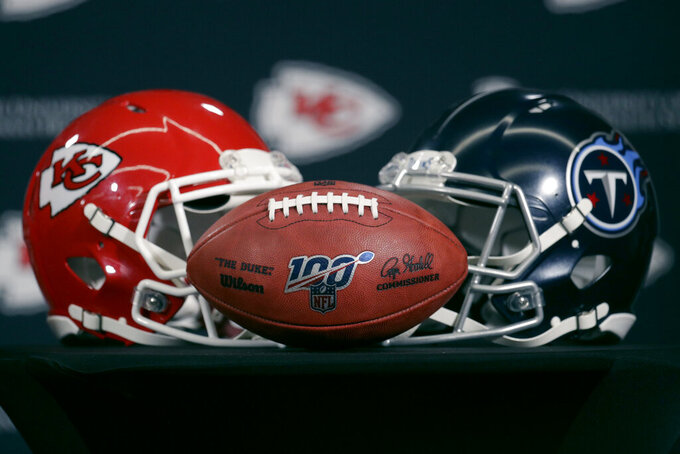 Helmets for the Kansas City Chiefs and the Tennessee Titans are displayed during a news conference for this weeks NFL conference championship football game at Arrowhead Stadium in Kansas City, Mo., Thursday, Jan. 16, 2020. (AP Photo/Charlie Riedel)