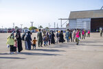 In this image provided by the U.S. Navy and taken on the military base in Rota, near Cadiz in southern Spain on Friday Aug. 27, 2021, evacuees from Afghanistan arrive at the Rota navy base. (U.S. Navy photo by Mass Communication Specialist 1st Class Nathan Carpenter, via AP)