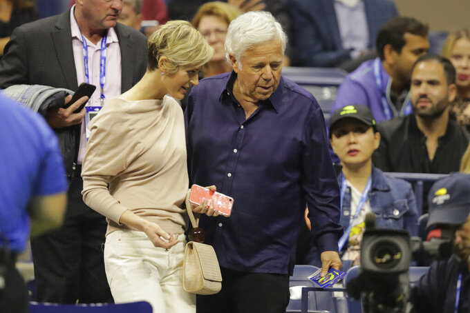 New England Patriots owner Robert Kraft, right, and Dana Blumberg find their seats during the men's singles semifinals of the U.S. Open tennis championships Friday, Sept. 6, 2019, in New York. (AP Photo/Charles Krupa)