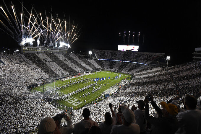 """Penn State takes the field for their NCAA college football game against Indiana amidst a """"Stripeout"""" crowd at Beaver Stadium in State College, Pa., on Saturday, Oct. 2, 2021. (AP Photo/Barry Reeger)"""