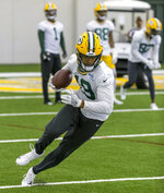 Green Bay Packers' Equanimeous St. Brown run a drill during NFL football practice Wednesday June 12, 2019, in Green Bay, Wisc. (AP Photo/Mike Roemer)