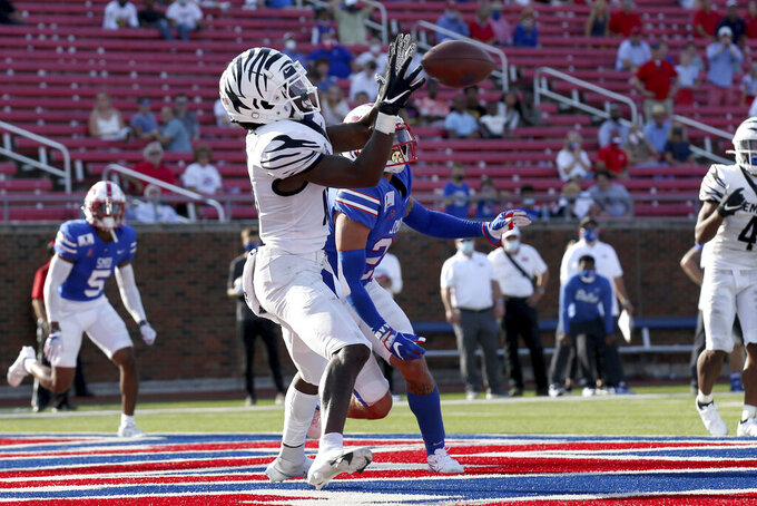 Memphis wide receiver Tahj Washington, left, makes a catch for a touchdown in front of SMU safety Donald Clay, background, during the second half of an NCAA college football game in Dallas, Saturday, Oct. 3, 2020. SMU beat Memphis 30-27. (AP Photo/Roger Steinman)