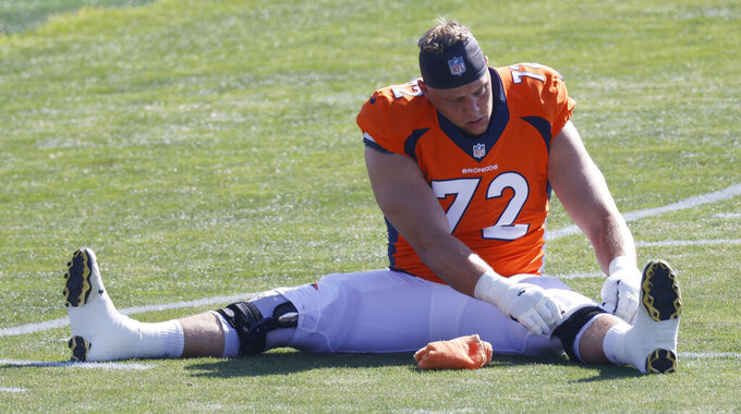 Denver Broncos offensive tackle Garett Bolles stretches before he takes part in drills during an NFL football practice Tuesday, Aug. 18, 2020, at the team's headquarter in Englewood, Colo. (AP Photo/David Zalubowski)