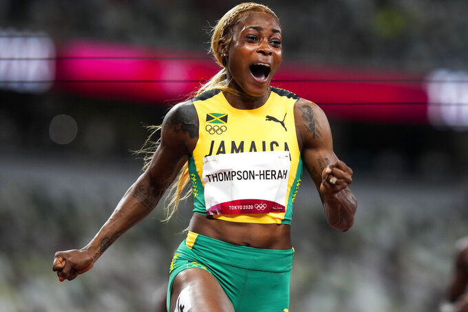 Elaine Thompson-Herah, of Jamaica, wins the women's 100-meter final at the 2020 Summer Olympics, Saturday, July 31, 2021, in Tokyo. (AP Photo/Martin Meissner)