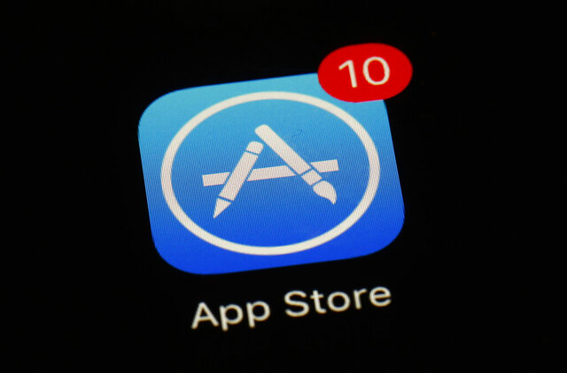 """FILE - This March 19, 2018, file photo shows Apple's App Store app in Baltimore. Apple has dropped the hugely popular """"Fortnite"""