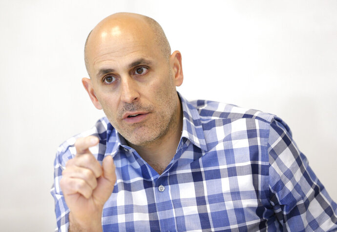 FILE - In this Monday, May 2, 2016, file photo, Jet.com CEO Marc Lore speaks during an interview in Hoboken, N.J.  Lore, Walmart's e-commerce chief, is leaving the world's largest retailer, Friday, Jan. 15, 2021, nearly five years after he joined to super charge its online business amid stiffer competition from online leader Amazon. Under Lore's stewardship, Walmart led the redesign of the company's website, expanded its online assortment from 10 million to more than 80 million and transformed its delivery network to add two-day and same day delivery.    (AP Photo/Seth Wenig, File)