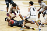 Texas A&M's Emanuel Miller (5) tries to hang onto the ball as Vanderbilt's Myles Stute, top left, and Scotty Pippen Jr. (2) close in during the second half of an NCAA college basketball game in the Southeastern Conference Tournament Wednesday, March 10, 2021, in Nashville, Tenn. (AP Photo/Mark Humphrey)