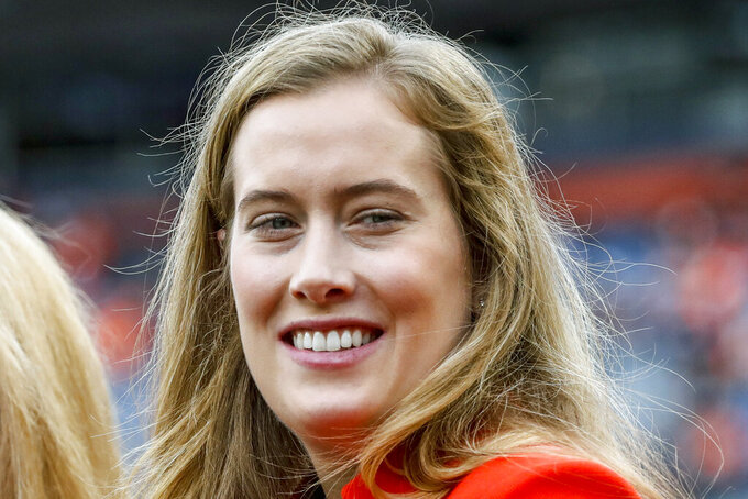 FILE - In this Nov. 4, 2018, file photo, Brittany Bowlen is shown prior to an NFL football game between the Denver Broncos and Houston Texans, in Denver. The Broncos will admit a limited number of fans to their second home game on Sept. 27, 2020, against Tom Brady and the Tampa Bay Buccaneers, Colorado Gov. Jared Polis said Tuesday, Sept. 8, 2020. Polis credited efforts by Bowlen, the Broncos' vice president of strategic initiatives and chair of the team's COVID-19 task force, for developing the game plan. (AP Photo/Jack Dempsey, File)