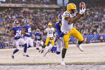 Green Bay Packers' Marcedes Lewis, right, catches a touchdown during the second half of an NFL football game against the New York Giants, Sunday, Dec. 1, 2019, in East Rutherford, N.J. (AP Photo/Adam Hunger)