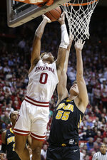 Indiana guard Romeo Langford (0) shoots over Iowa forward Luka Garza (55) during the second half of an NCAA college basketball game in Bloomington, Ind., Thursday, Feb. 7, 2019. Iowa won 77-72. (AP Photo/AJ Mast)
