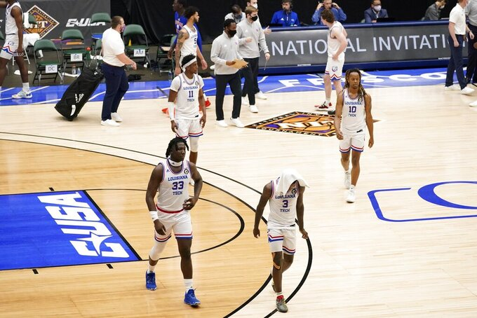Louisiana Tech players walk off the court after an NCAA college basketball game against Mississippi State in the semifinals of the NIT, Saturday, March 27, 2021, in Frisco, Texas. (AP Photo/Tony Gutierrez)