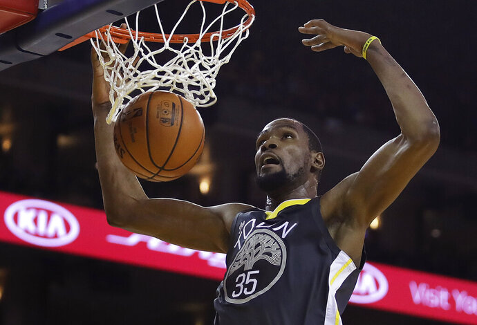 Golden State Warriors' Kevin Durant (35) scores against the Miami Heat during the second half of an NBA basketball game, Sunday, Feb. 10, 2019, in Oakland, Calif. (AP Photo/Ben Margot)