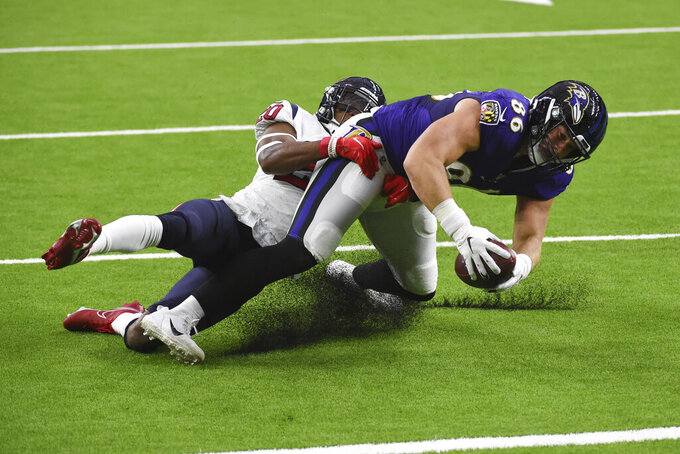 Baltimore Ravens tight end Nick Boyle (86) makes a catch in front of Houston Texans strong safety Justin Reid (20) during the first half of an NFL football game Sunday, Sept. 20, 2020, in Houston. (AP Photo/Eric Christian Smith)
