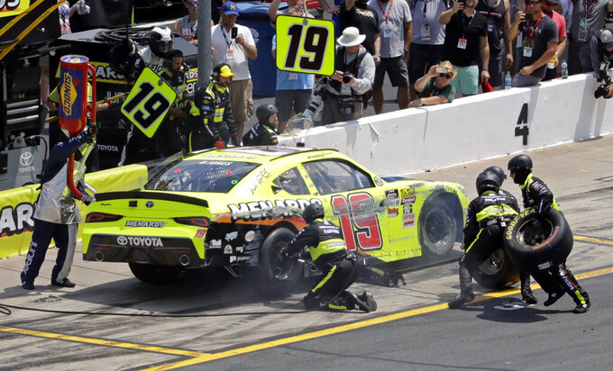 Crew members try to repair the car of Brandon Jones after a crash during the NASCAR Xfinity Series auto race at Charlotte Motor Speedway in Concord, N.C., Saturday, May 25, 2019. (AP Photo/Chuck Burton)