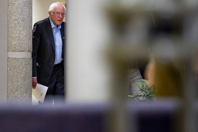 Democratic presidential candidate Sen. Bernie Sanders, I-Vt., arrives to speak at a campaign stop at the State Historical Museum of Iowa, Monday, Jan. 20, 2020, in Des Moines, Iowa. (AP Photo/Andrew Harnik)