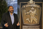 FILE - In this Dec. 22, 2012, file photo, former Pittsburgh Steelers Hall of Fame running back Franco Harris stands on the spot of the