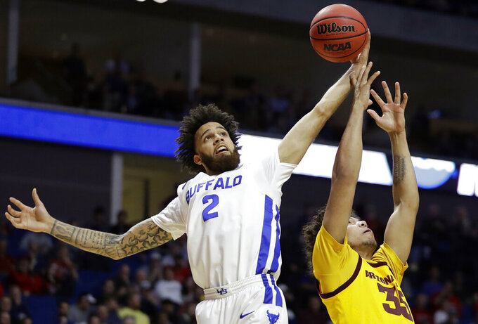 Buffalo's Jeremy Harris (2) and Arizona State's Taeshon Cherry reach for a rebound during the first half of a first round men's college basketball game in the NCAA Tournament Friday, March 22, 2019, in Tulsa, Okla. (AP Photo/Jeff Roberson)