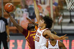 Iowa State forward Solomon Young shoots over Texas forward Jericho Sims (20) during the second half of an NCAA college basketball game, Tuesday, Jan. 5, 2021, in Austin, Texas. (AP Photo/Eric Gay)