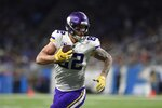 FILE - In this Dec. 23, 2018, file photo, Minnesota Vikings tight end Kyle Rudolph runs into the end zone untouched for a touchdown during the second half of an NFL football game against the Detroit Lions in Detroit. Rudolph has  had a pretty stable career with just the Vikings, but he was involved in at least one significant trade. In his father's fantasy football keeper league.(AP Photo/Jose Juarez, File)