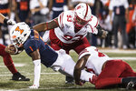 Illinois' Isaiah Williams (1) reaches for extra yardage as Nebraska's Damion Daniels (93) defends in the first half of an NCAA college football game, Saturday, Sept. 21, 2019, in Champaign, Ill. (AP Photo/Holly Hart)