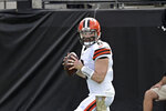 Cleveland Browns quarterback Baker Mayfield looks for a receiver against the Jacksonville Jaguars during the first half of an NFL football game, Sunday, Nov. 29, 2020, in Jacksonville, Fla. (AP Photo/Phelan M. Ebenhack)
