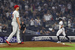 Philadelphia Phillies pitcher Brandon Kintzler walks on the mound after giving up a solo home run to New York Yankees' Giancarlo Stanton during the seventh inning of a baseball game Tuesday, July 20, 2021, in New York. (AP Photo/Adam Hunger)