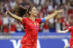 FILE - In this July 2, 2019, file photo, United States' Alex Morgan celebrates after scoring her side's second goal during the Women's World Cup semifinal soccer match against England at the Stade de Lyon, outside Lyon, France. The U.S. national soccer team star and husband Servando Carrasco, who is a midfielder for the LA Galaxy, are expecting their first child, according to an announcement Wednesday, Oct. 23, 2019, on social media. (AP Photo/Alessandra Tarantino)