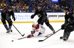 Montreal Canadiens left wing Jonathan Drouin (92) shoots after being tripped by Tampa Bay Lightning defenseman Dan Girardi (5) during the first period of an NHL hockey game Saturday, Feb. 16, 2019, in Tampa, Fla. (AP Photo/Jason Behnken)