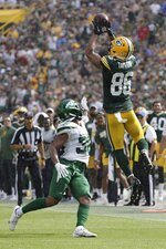 Green Bay Packers' Malik Taylor catches a pass in front of New York Jets' Isaiah Dunn during the first half of a preseason NFL football game Saturday, Aug. 21, 2021, in Green Bay, Wis. (AP Photo/Mike Roemer)
