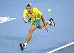 Alex de Minaur of Australia plays a shot during his match against Alexander Zverev of Germany at the ATP Cup tennis tournament in Brisbane, Australia, Friday, Jan. 3, 2020. (AP Photo/Tertius Pickard)