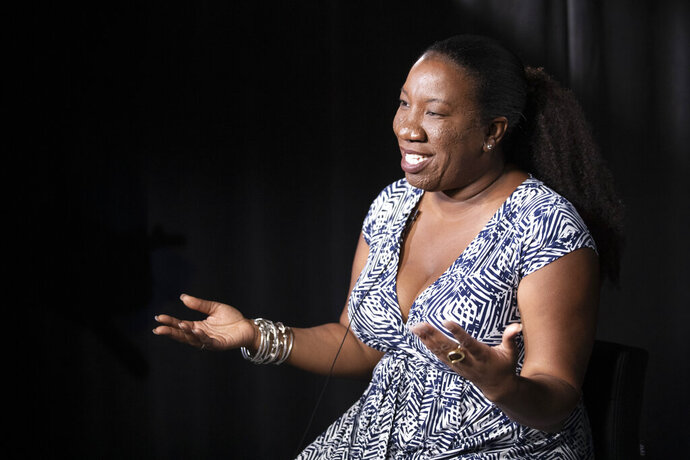 In this Friday, Oct. 11, 2019, photo Tarana Burke, founder and leader of the #MeToo movement, gestures as she speaks during an interview, in New York. Burke is using the second anniversary of the movement to launch a new effort intended to mobilize voters heading into the 2020 election.  The new hashtag #MeTooVoter was unveiled Tuesday, Oct. 15 on the same day as the fourth Democratic presidential debate and reflects a frustration among activists that issues of sexual violence and harassment have largely been absent from the debate stage and campaign trail.  (AP Photo/Mary Altaffer)