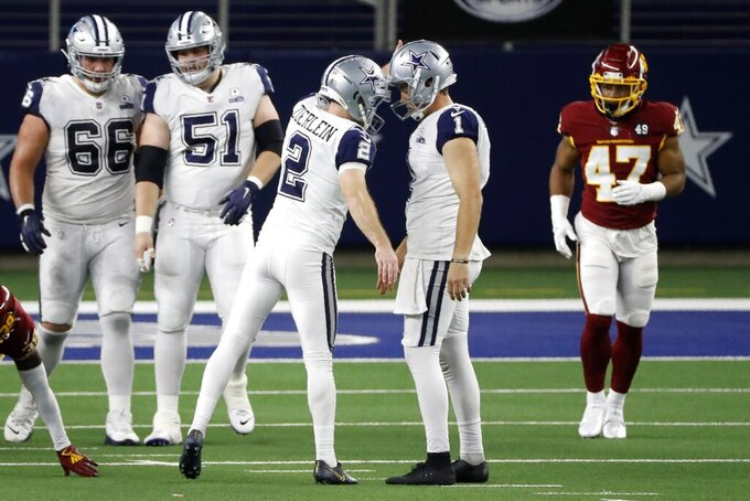 Dallas Cowboys' Greg Zuerlein (2) and Hunter Niswander (1) celebrate Zuerlein's field goal as Connor McGovern (66), Adam Redmond (51) and and Washington Football Team linebacker Khaleke Hudson (47) look on in the second half of an NFL football game in Arlington, Texas, Thursday, Nov. 26, 2020. (AP Photo/Roger Steinman)