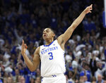 Kentucky's Keldon Johnson (3) celebrates a 3-point basket during the first half of an NCAA college basketball game against Tennessee in Lexington, Ky., Saturday, Feb. 16, 2019. (AP Photo/James Crisp)